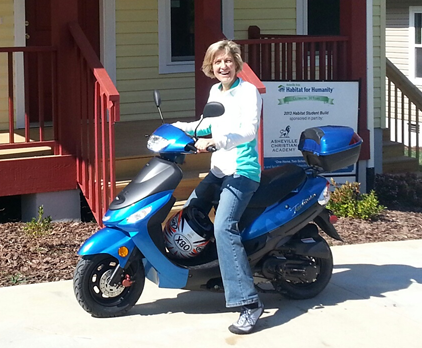 Raffle winner on her new scooter