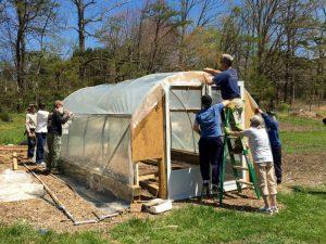 Repairing Hoop House in Swannanoa Community Garden